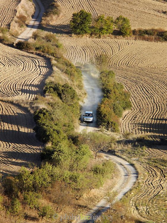 An offroad vehicle drives a dirt track in Basque countryside, near San Sebastian, Spain