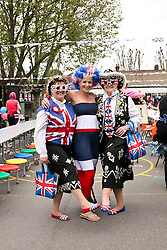 © Licensed to London News Pictures. 31/05/2012. .Newham East London, UK..East London Gets the Party Started..Jaimie Broom ( centre) is joined  Pearly Queens  Doreen Golding and Christe Prosser from New City Primary School as the school start the celebrations for the  Diamond Jubilee Weekend,  with street party style lunch for the pupils in the school playground. .Photo credit : Andrew Baker/LNP