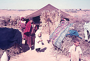 Nomadic Bedouin people by their desert tent in North Africa