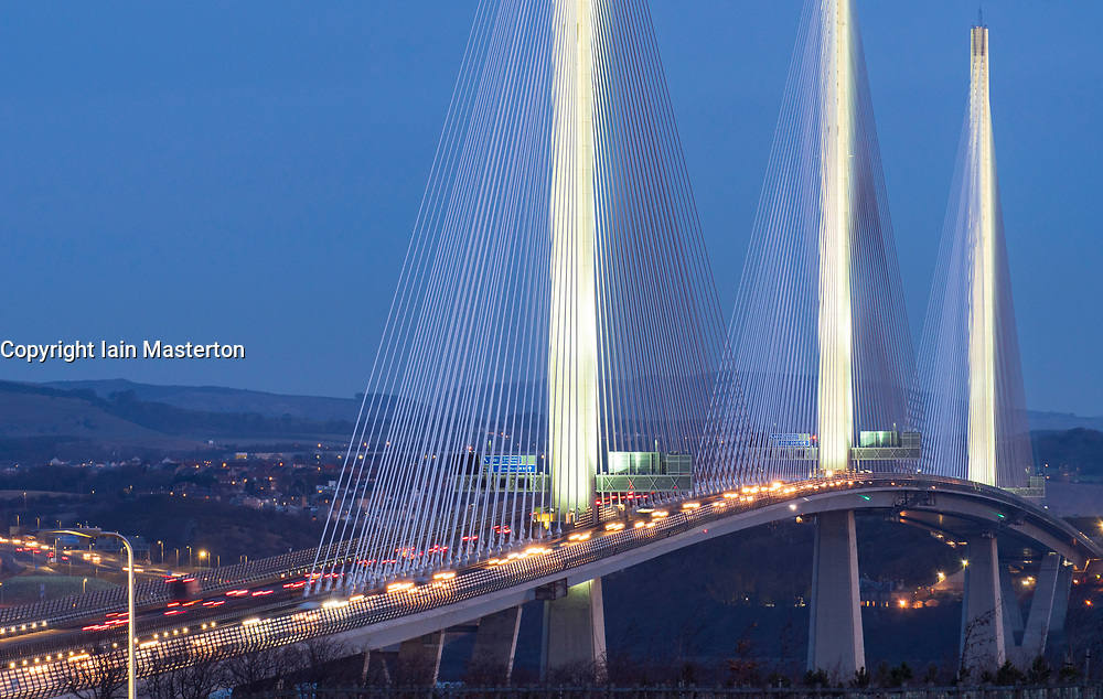 South Queensferry, Scotland, UK. January 18, 2019.View at sunrise of rush-hour traffic travelling to Edinburgh across the Queensferry Crossing Bridge with it's new lighting design in freezing but clear weather conditions.