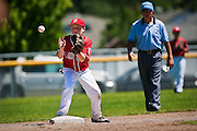 Braesan Richmond reaches to catch the flip to second base, making the fielder's choice third out during the fourth inning against Post Falls.