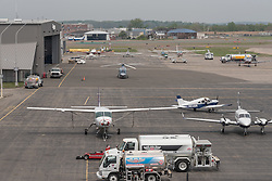 Sikorsky Airport Apron with parked planes, Stratford CT. View from Roof of the Stratford School For Aviation Maintenance Technicians. Looking East.