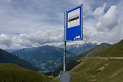 Bus stop near the top of the Jaufenpass, the highest point at 2,094 metres on the road between Meran-merano and Sterzing-Vipiteno in South Tyrol, Italy. Roads in south Tyrol are considered to be the best well-kept in Italy and buses seem to reach the highest points with little trouble. The Jaufenpass (Italian: Passo di Monte Giovo) (alt 2094m.) is a high mountain pass in the Alps in the South Tyrol in Italy. It connects Meran and Sterzing on the road to the Brenner Pass. It is the northernmost pass in the Alps that is completely in Italy. The pass road is very winding, with many switchbacks.