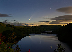 © Licensed to London News Pictures. 11/07/2020. Lake Vyrnwy, UK. Comet Neowise flying over lake Vyrnwy in Powys, Wales. The comet, which was first discovered by the NEOWISE space telescope on March 27, will make its closest approach to Earth on July 23 when it will be 64 million miles away. Photo credit: Jamie Cooper/LNP
