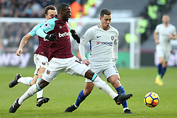 9 December 2017 - Premier League Football - West Ham United v Chelsea - Pedro Mba Obiang of West Ham stretches to intercept Eden Hazard of Chelsea - Photo: Charlotte Wilson / Offside