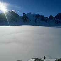 Mountaineer Mark Synnott ferries loads to the base of Great Sail Peak, above fog in Stewart Valley on Canada's Baffin Island.