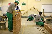 Prisoners leaerning building skills in the workshop. HMP Wandsworth, London, United Kingdom
