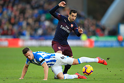 Huddersfield Town's Jonathan Hogg (left) and Arsenal's Henrikh Mkhitaryan battle for the ball during the Premier League match at the John Smith's Stadium, Huddersfield.
