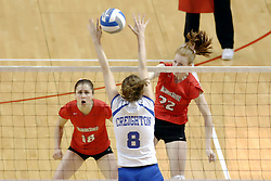24 November 2006: Lindley McDavid strikes the ball through the hands of Lauren Bloemke during a Quarterfinal match between the Illinois State University Redbirds and the Creighton University Bluejays. The Tournament was held at Redbird Arena on the campus of Illinois State University in Normal Illinois.<br />
