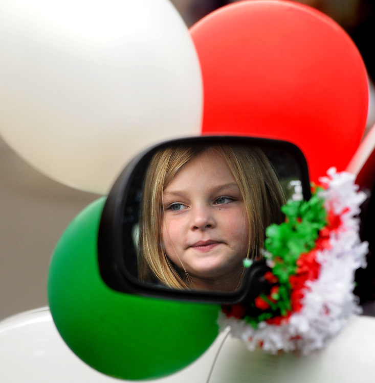 (Mara Lavitt — New Haven Register) <br /> October 13, 2013 Branford<br /> The Greater New Haven Area Columbus Day Parade rotates between six towns. This year it was in Branford. Scarlett Vernucci age 6 of Fairfield, reflected in the truck mirror she rode in the parade.