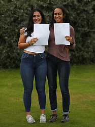August 17, 2017 - London, LONDON, ENGLAND - LONDON, UK. .TWINS RECEIVE 4A*s and 3A's BETWEEN THEM IN A LEVEL RESULTS.Twins from Lady Eleanor Holles school, Anoushka Persson (L) and Lata Persson (R) react to receiving their A level results, between them achieving 4A*s and 3A's. Lata is going to Cambridge University to study Economics and Anoushka is going to Durham to study Spanish and History. Lady Eleanor Holles School in Hampton, south-west London achieved 96% of students passing with grades A*-B. (Credit Image: © Lnp/London News Pictures via ZUMA Wire)