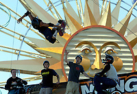 """Jul 01, 2003; Anaheim, California, USA; Professional Skateboarder BOB BURNQUIST grabs his board in while doing a trick off the 14' tall vert ramp infront of other extreme sports athletes performing live at Disney's California Adventure """"X Games Experience"""".  Disney park has built two X-Arena's specifically for this 41 day event highlighting extreme sports for the launch of the 2003 ESPN X Games.<br />Mandatory Credit: Photo by Shelly Castellano/Icon SMI"""