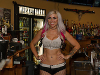 Emily Richter behind the bar at the Whiskey Barrel in downtown Laconia.  (Karen Bobotas/for the Laconia Daily Sun)