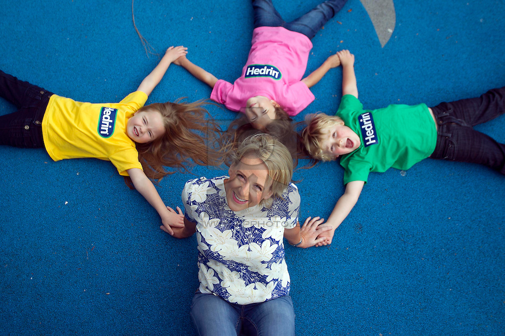 """Repro Free: 09/09/2013 TV3's """"Take a Peek"""" Sybil Mulcahy is pictured with Isabelle Evans (6), Allegra Lupu (6), both from Clonee and Jamie Wilson (5) from Knocklyon at the launch of two new products to the Hedrin range that treats head lice, Treat & Go and Hedrin Protect & Go to help deal with the back to school outbreaks, a common occurrence with young children being in such close proximity. For the truth behind on all knits and all the facts on how to treat head lice visit www.onceaweektakeapeek.ie Picture Andres Poveda"""