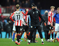 Football - 2019 / 2020 Emirates FA Cup - Fourth Round: Brentford vs. Leicester City<br /> <br /> Emiliano Marcondes of Brentford shakes hands with fellow Denmark player,Kasper Schmeichel of Leicester after the match, at Griffin Park.<br /> <br /> COLORSPORT/ANDY COWIE