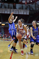 01 January 2009: Emily Hanley splits defenders Kelsey Crites and Megan Neuvirth to get the ball to the basket. The game between the Creighton Bluejays and the Illinois State Redbirds ended with the Redbirds on top by a score of 63-43 on Doug Collins Court inside Redbird Arena on the campus of Illinois State University, Normal IL.