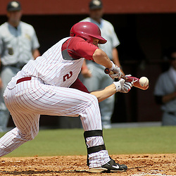 June 05, 2011; Tallahassee, FL, USA; Alabama Crimson Tide right fielder Andrew Miller (2) bunts for a one run single during the first inning of the Tallahassee regional of the 2011 NCAA baseball tournament against the UCF Knights at Dick Howser Stadium. Alabama defeated UCF 12-5. Mandatory Credit: Derick E. Hingle