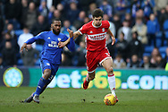 George Friend of Middlesbrough ® breaks away from Junior Hoilett of Cardiff city. EFL Skybet championship match, Cardiff city v Middlesbrough at the Cardiff city Stadium in Cardiff, South Wales on Saturday 17th February 2018.<br /> pic by Andrew Orchard, Andrew Orchard sports photography.