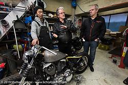 Hideya Togashi (L) with Harley-Davidson head of design Ray Drea and head of Harley-Davidson Japan Stuart Farrell at Hideya's Hide Motorcycle's shop. Tokyo, Japan. Tuesday, December 9, 2014. Photograph ©2014 Michael Lichter.