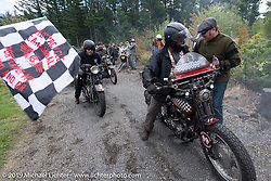 Jon Neuman is greeted by Race organizer Jason Sims as he rides his 1928 Harley-Davidson JDH over the finish line of the Motorcycle Cannonball coast to coast vintage run. Stage 15  (51 miles - the Grand Finish) from The Dalles to Stevenson, OR. Sunday September 23, 2018. Photography ©2018 Michael Lichter.