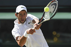 LONDON, July 16, 2018  Novak Djokovic of Serbia hits a return during the men's singles final match against Kevin Anderson of South Africa at the Wimbledon Championships 2018 in London, Britain, on July 15, 2018. Novak Djokovic won 3-0. (Credit Image: © Stephen Chung/Xinhua via ZUMA Wire)