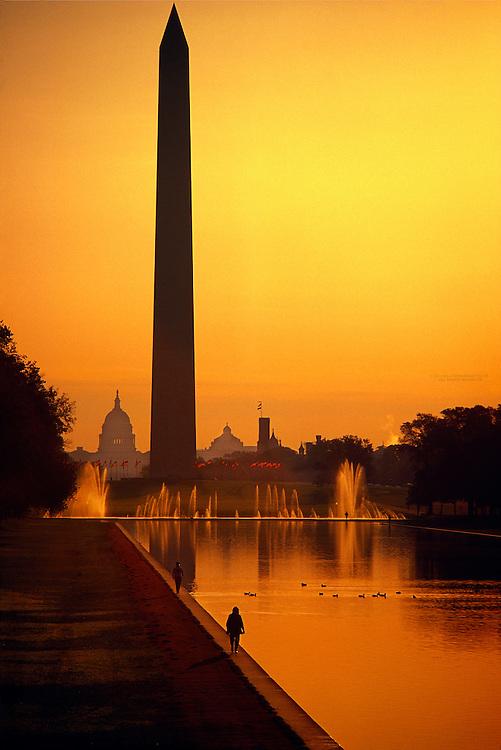 People walking along the Reflecting Pool with the Washington Monument and United States Capitol behind, Washington, D.C.