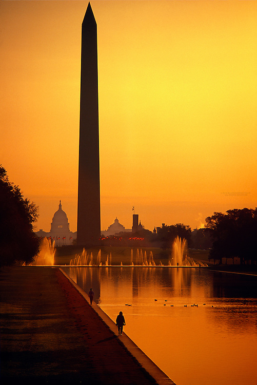 People walking along the Reflecting Pool with the Washington Monument and United States Capitol behind, Washington, D.C.