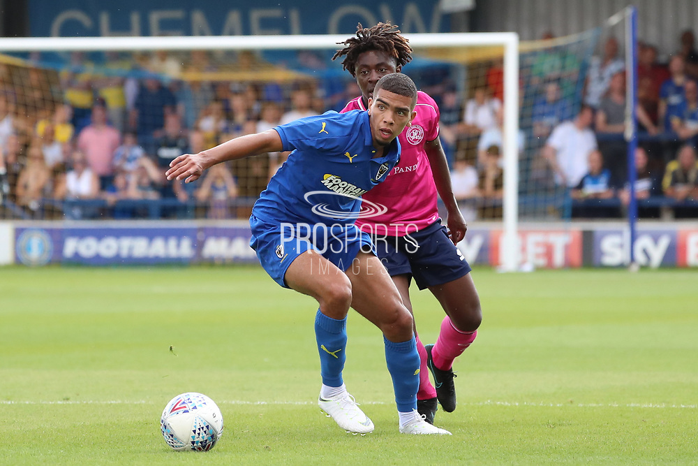 Wimbledon defender Tennai Watson  battles for possession during the Pre-Season Friendly match between AFC Wimbledon and Queens Park Rangers at the Cherry Red Records Stadium, Kingston, England on 14 July 2018. Picture by Matthew Redman.