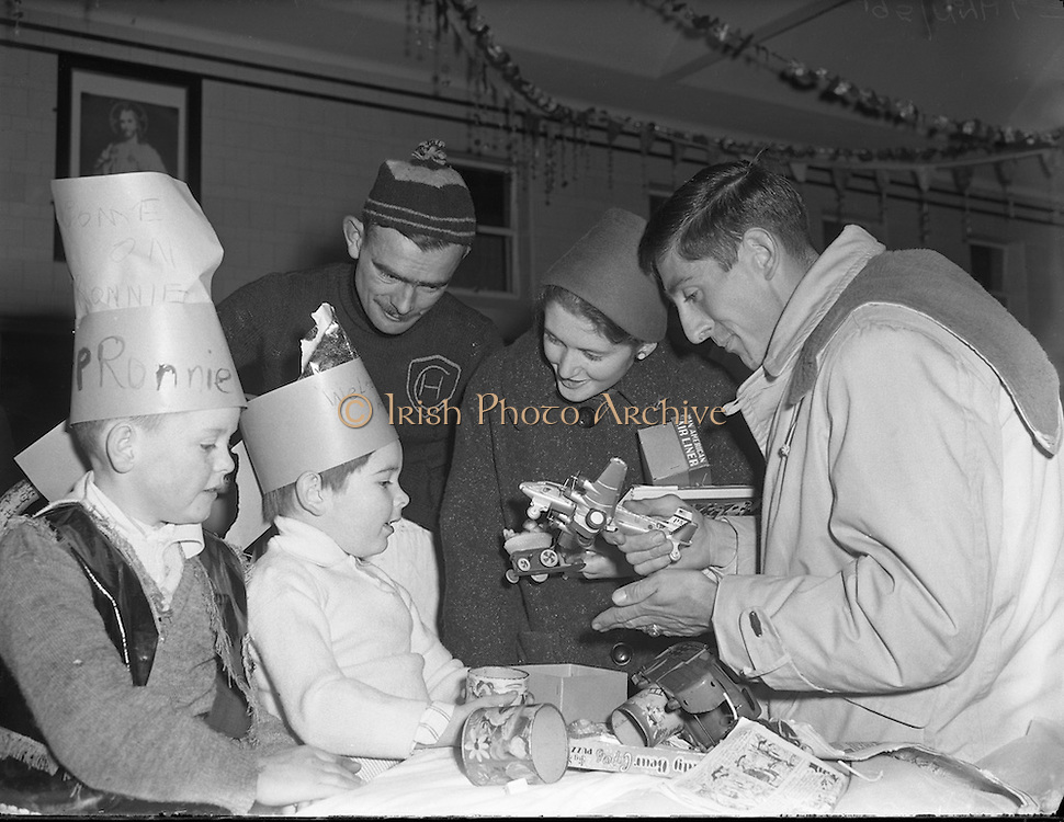 22/12/1956<br /> 12/22/1956<br /> 22 November 1956<br /> <br /> Ronnie Delaney at Cappagh Hospital<br /> <br /> <br /> Ronald Michael Delany (born 6 March 1935), better known as Ron or Ronnie is a former Irish athlete, who specialised in middle distance running.<br /> <br /> Born in Arklow, Delany moved with his family to Dublin when he was 6. His father had got a job in Jacobs Biscuit Factory and there Delany went to Catholic University School.<br /> <br /> Delany studied in the United States at Villanova University, where he was coached by the well-known track coach Jumbo Elliott. His first achievement of note was reaching the final of the 800m at the 1954 European Championships in Bern.<br /> <br /> In 1956, he became the seventh runner to join the club of Four-minute milers, but nonetheless struggled to make the Irish team for the 1956 Summer Olympics held in Melbourne.<br /> <br /> Delany qualified for the Olympic 1500 m final, in which home runner John Landy was the big favourite. Delany kept close to Landy until the final lap, when he started a crushing final sprint, winning the race in a new Olympic Record.[3] Delany thereby became the first Irishman to win an Olympic title in athletics since Bob Tisdall in 1932.<br /> <br /> Delany won the Bronze medal at the 1958 European Championships at 1500m<br /> <br /> Delany went on to represent Ireland once again at the 1960 Summer Olympics held in Rome, this time in the 800 metres. He finished 6th in his quarter-final.<br /> <br /> He remained the last Olympics champion of Ireland for 36 years, until Michael Carruth won the gold medal in boxing at the 1992 Olympics in Barcelona.<br /> <br /> Delany continued his running career in North America, winning four successive AAU titles in the mile, adding to his total of four Irish national titles, and three NCAA titles. He was next to unbeatable on indoor tracks over that period, which included a 40-race winning streak. He broke the World Indoor Mile Record on three occa