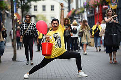 "© Licensed to London News Pictures. 05/09/2018. LONDON, UK. A fundraising volunteer prepares to join fans of Freddie Mercury and members of the public in Carnaby Street donning moustaches during ""Freddie for a Day"", a fundraising event in aid of the Mercury Phoenix Trust on Freddie Mercury's birthday.  Queen tribute band ""Bulsara and the Queenies"" sang iconic songs entertaining crowds.  Photo credit: Stephen Chung/LNP"
