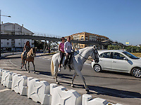 Sunday morning canter. Mother and daughters negotiate a roundabout in San Pedro de Alcantara, Marbella, Spain, October, 2016, 201610092851<br /><br />Copyright Image from Victor Patterson, 54 Dorchester Park, <br />Belfast, UK, BT9 6RJ<br /><br />t1: +44 28 9066 1296 (from Rep of Ireland 048 9066 1296)<br />t2: +44 28 9002 2446 (from Rep of Ireland 048 9002 2446)<br />m: +44 7802 353836<br /><br />e1: victorpatterson@me.com<br />e2: victorpatterson@gmail.com<br /><br />www.victorpatterson.com<br /><br />Please see my Terms and Conditions of Use at VICTORPATTERSON.COM. It is IMPORTANT that you familiarise yourself with them.<br /><br />Images used on the Internet must be visibly watermarked i.e. ©VICTORPATTERSON.COM within the body of the image and copyright metadata must not be deleted. Images used on the Internet have a size restriction of 4kbs and are chargeable at the then current NUJ rates.<br /><br />This image is only available for the use of the download recipient i.e. television station, newspaper, magazine, book publisher, etc, and must not be passed on to any third party. It is also downloaded on condition that each and every usage is notified within 7 days to victorpatterson@me.com<br /><br />The right of Victor Patterson to be identified as the author is asserted in accordance with The Copyright Designs And Patents Act (1988)