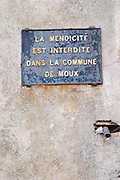 Signs saying: It is forbidden to beg in the commune of Moux. Les Corbieres. Languedoc. France. Europe.