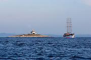 Yacht passing the island of Pokonji Dol, near Hvar, Croatia