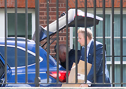 © Licensed to London News Pictures. 13/07/2016. London, UK. Boxes are loaded into a car on Downing Street on the day Prime Minister David Cameron leaves Number 10 and is replaced by new Prime Minister Theresa May. Photo credit : Tom Nicholson/LNP