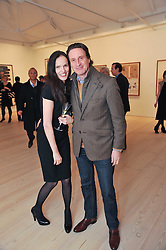 BETTINA VON HASE and TIM ATTIAS at a private view of work by Brian Clarke - Works on Paper 1969-2011 held in the Phillips de Pury Galleries, The Saatchi Gallery, London on 28th February 2011.