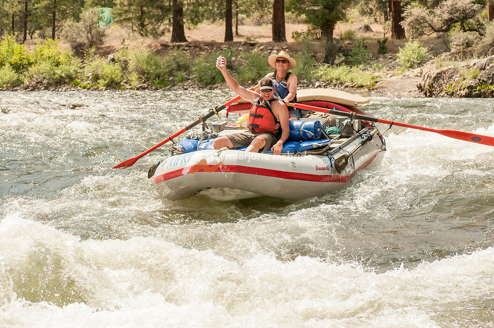 Laughter and saving the beer while rafting Marble Creek on the Middle Fork of the Salmon River, Idaho.