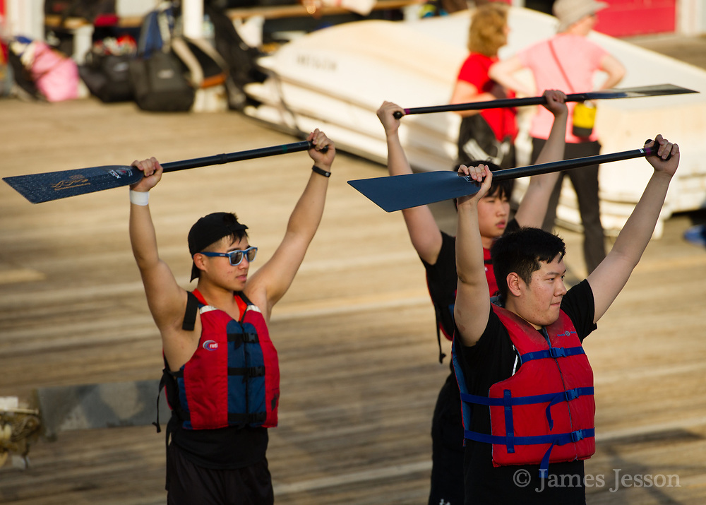Crowds of participants gathered to stretch and practice for the Boston Dragon Boat Festival at MIT Pierce Boathouse in Cambridge, May 17, 2017.   [Wicked Local Photo/James Jesson]