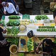 People buying vegetables at the Central Market in the capital city of Mauritius