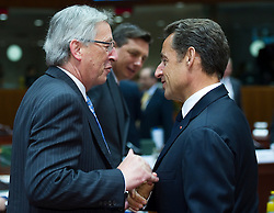 Jean-Claude Juncker, Luxembourg's prime minister, left, speaks with Nicolas Sarkozy, France's president, during the European Summit meeting at EU Council headquarters in Brussels, Belgium, on Thursday, June 17, 2010. (Photo © Jock Fistick)