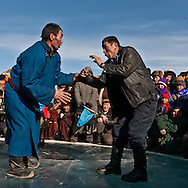 Mongolia. Sumo hand wrestling on ice. during the Ice festival on the frozen Khuvsgul lake. - siberia border - for the mongol new year ,  tsagaan sar, in the cold winter   Khuvsgul province -