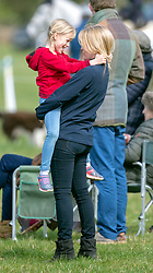 Autumn Phillips with her daughter Isla as they watch Zara Tindall compete at the Land Rover Gatcombe Horse Trials on the estate of the Princess Royal.