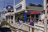 Weekend visitors and tourists dining outdoors in the small coastal community town of Stinson Beach, Marin County, California