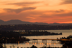 North America, United States, Washington, Lake Washington, Seattle and Olympic Mountains viewed from Bellevue at sunset.