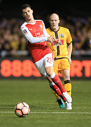 20 February 2017 - The FA Cup - (5th Round) - Sutton United v Arsenal - Granit Xhaka of Arsenal in action with Nicky Bailey of Sutton United - Photo: Marc Atkins / Offside.