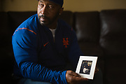 VALLEY GRANDE, AL – FEBRUARY 7, 2019: Maury Davis, 51, holds a photograph showing himself (left) with his best friend Jeff Williams (right, seated). On June 28, 1992, at age 12, Davis accidentally shot his best friend as the two were playing with a handgun in his family's Bronx apartment. The injury left his friend paralyzed for life. Despite the trauma, Davis and his friend, Jeff Williams, maintain an enduring friendship. CREDIT: Bob Miller for The New York Times