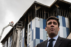 """© Licensed to London News Pictures. 16/11/2019. Bolton, UK. ANDY BURNHAM Mayor of Greater Manchester at a the site of the blaze . Firefighters work at the scene where a fire broke out overnight (15th/16th November 2019) at a block of flats known as """" The Cube """" , in Bolton Town Centre . At least two people are known to have been treated by paramedics at the scene of the six-story block , which is occupied by students of the University of Bolton . Photo credit: Joel Goodman/LNP"""