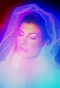 Portrait of a pretty woman with glowing veil.Black light