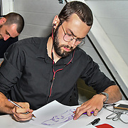 Drivetribe team - Sketch off competition at the London Motor & Tech Show opening day on 16 May 2019, at Excel London, UK.