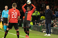 Christ-Emmanuel Maouassa (17) of Rennes takes a throwin in front of Rennes Manager Julien Stephan during the Europa League match between Celtic and Rennes at Celtic Park, Glasgow, Scotland on 28 November 2019.