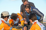 Het technisch team controleert de werking van de datazenders. In de vroege ochtend worden de kwalificaties gereden. In de buurt van Battle Mountain, Nevada, strijden van 10 tot en met 15 september 2012 verschillende teams om het wereldrecord fietsen tijdens de World Human Powered Speed Challenge. Het huidige record is 133 km/h.<br /> <br /> The technical team is checking the data connection with the supplier. Near Battle Mountain, Nevada, several teams are trying to set a new world record cycling at the World Human Powered Vehicle Speed Challenge from Sept. 10th till Sept. 15th. The current record is 133 km/h.